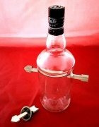 Arrow Through Bottle and Coin by Ralf Rudolph (Fairmagic)